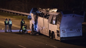 A bus that was carrying teenage passengers sits on the side of a highway after it hit an overpass on the Southern State Parkway in Lakeview, N.Y., on April 9, 2018. (Kevin Hagen / AP)