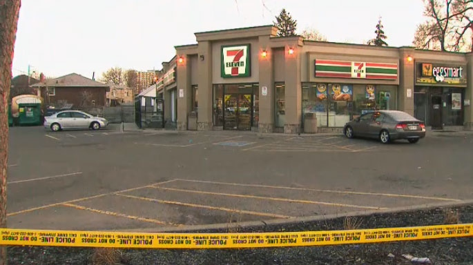 Police tape blocks off the parking lot to a 7/11 location in East York where a man was fatally stabbed in the early morning hours of April 10, 2018.