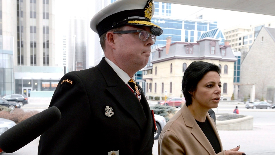 Vice-Admiral Mark Norman arrives with his lawyer Marie Henein for his first appearance at his trial for breach of trust, at the courthouse in Ottawa on Tuesday, April 10, 2018. THE CANADIAN PRESS/Justin Tang