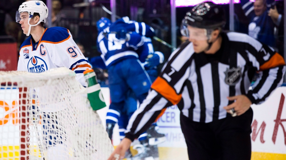 Referee Garrett Rank signals a good goal during overtime NHL hockey action in Toronto on Tuesday, Nov. 1, 2016. (THE CANADIAN PRESS / Nathan Denette)