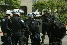 Montreal police in riot gear forced dozens of squatters out of an abandoned building on St. Patrick St. in Point St. Charles on Saturday, May 30, 2009.