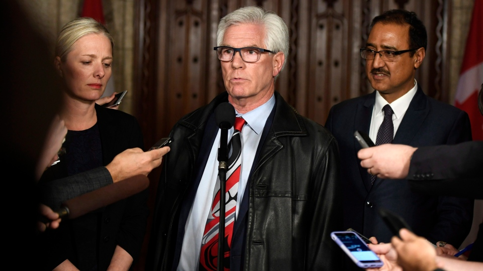 Minister of Natural Resources Jim Carr speaks to reporters with Minister of Environment and Climate Change Catherine McKenna and Minister of Infrastructure and Communities Amarjeet Sohi, after an emergency cabinet meeting on Parliament Hill in Ottawa on Tuesday, April 10, 2018. THE CANADIAN PRESS/Justin Tang
