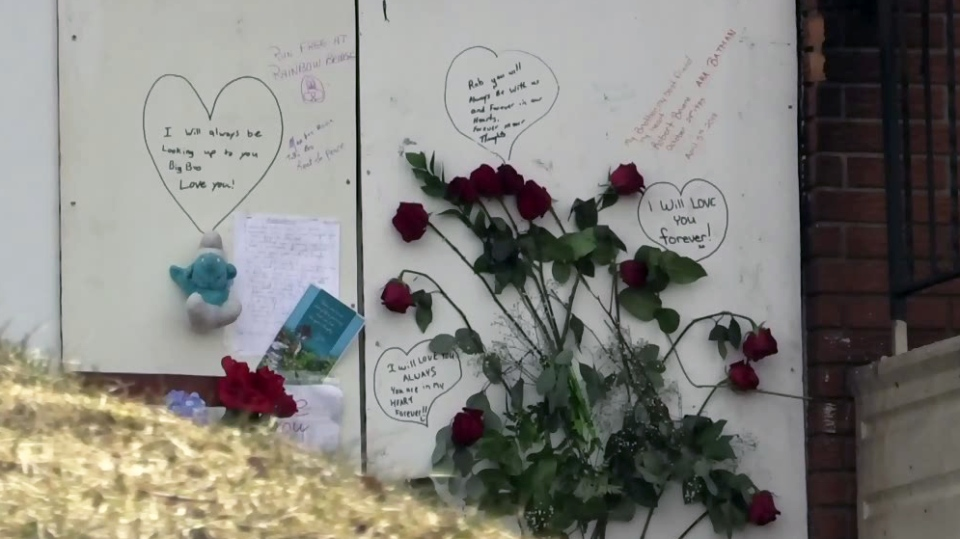 Messages of support were left at a home on Queen Street East in Cambridge following a deadly fire.
