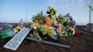 A makeshift memorial is pictured at the intersection of of a fatal bus crash near Tisdale, Sask., Tuesday, April, 10, 2018. A bus carrying the Humboldt Broncos hockey team crashed into a truck en route to Nipawin for a game Friday night killing 15 and sending over a dozen more to hospital. THE CANADIAN PRESS/Jonathan Hayward