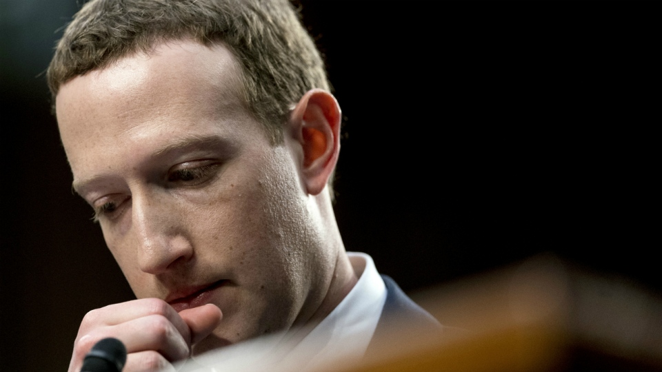 Facebook CEO Mark Zuckerberg pauses while testifying before a joint hearing of the Commerce and Judiciary Committees on Capitol Hill in Washington about the use of Facebook data to target American voters in the 2016 election, on Tuesday, April 10, 2018. (AP Photo/Andrew Harnik)