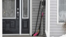 Hockey sticks sit on the front porch of a house in Humboldt, Sask., on Monday, April 9, 2018. (Jonathan Hayward / THE CANADIAN PRESS)