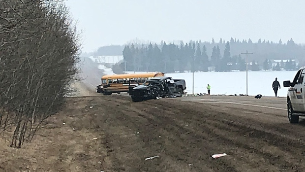 Driver injured in collision with school bus near Sylvan Lake