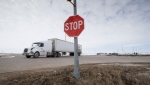 The stop sign on highway 335 is seen at the intersection of highway 35 near Tisdale, Sask., Tuesday, April, 10, 2018. This is the intersection where a bus carrying the Humboldt Broncos hockey team crashed into a truck en route to Nipawin for a game Friday night killing 15 and sending over a dozen more to the hospital. (THE CANADIAN PRESS/Jonathan Hayward)