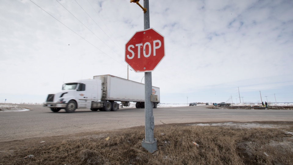 The stop sign on Highway 335 is seen at the intersection of Highway 35 near Tisdale, Sask., Tuesday, April, 10, 2018. A bus carrying the Humboldt Broncos hockey team crashed into a semi at the intersection Friday, April 6, 2018. (THE CANADIAN PRESS/Jonathan Hayward)