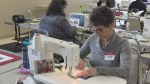 Volunteers sew quilts for local veterans