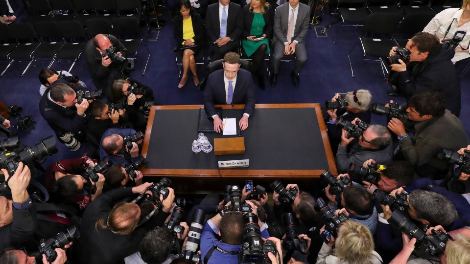 Facebook CEO Mark Zuckerberg takes his seat to testify before a joint hearing of the Commerce and Judiciary Committees on Capitol Hill in Washington, Tuesday, April 10, 2018, about the use of Facebook data to target American voters in the 2016 election. (AP Photo/Pablo Martinez Monsivais)