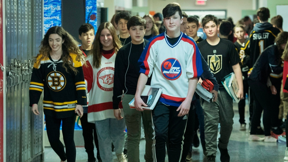John Rennie high school students wear jersey's at their school in Montreal, Thursday, April, 12, 2018, in honour of the victims of the Humboldt bus crash. (THE CANADIAN PRESS/Graham Hughes)