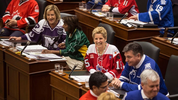 Ontario Premier Kathleen Wynne joins other MPPs in wearing sports jerseys in tribute to the victims of the Humboldt Broncos bus crash, as they attend a session at the Queen's Park Legislature, in Toronto on Thursday, April 12, 2018. (THE CANADIAN PRESS/Chris Young)