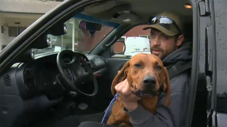 Red and his owner James Dumont reunited at Coastal Animal Services in Duncan, where the dog was held for a week after being found wandering a nearby road. April 12, 2018. (CTV Vancouver Island)