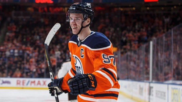f7455b7d63b Edmonton Oilers' Connor McDavid (97) celebrates a goal against the Anaheim  Ducks during second period NHL action in Edmonton, Alta., on Sunday, March  25, ...