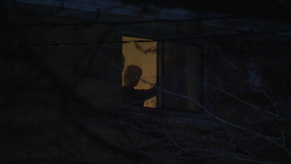 A man in seen in the window of a house on Sherring Street in Cambridge as police negotiate on April 12, 2018 (CTV Kitchener)