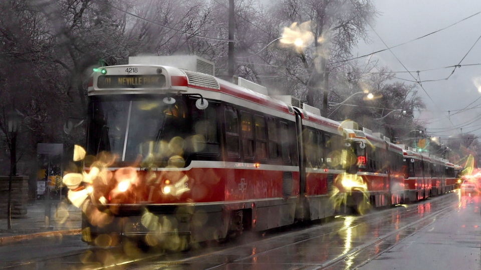 Shown through a car's windshield, streetcars are backed up along Queen St. in Toronto, Tuesday, Feb.7, 2017. Freezing rain is forecast for central Ontario and the rest of the south as a weather system moves across the province.THE CANADIAN PRESS/Frank Gunn