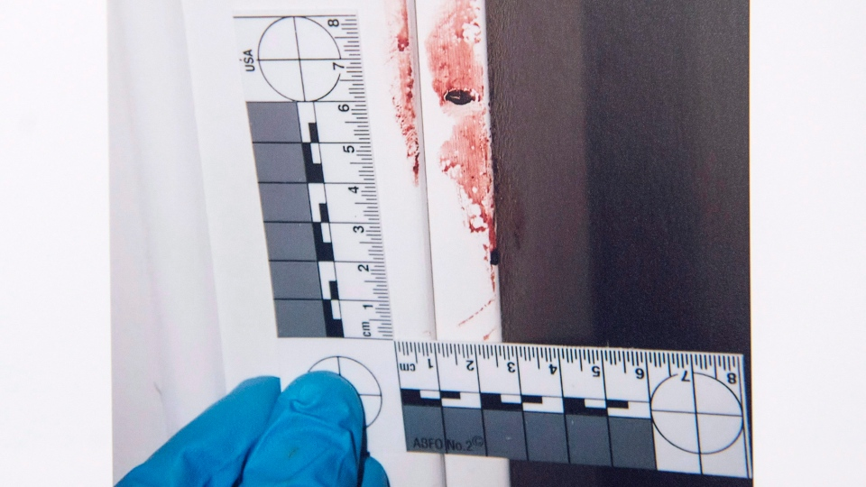 A Halifax Regional Police photo of the murder scene, part of the evidence from the Nicholas Butcher murder trial, is seen at Nova Scotia Supreme Court in Halifax on Thursday, April 12, 2018. (THE CANADIAN PRESS/Andrew Vaughan)