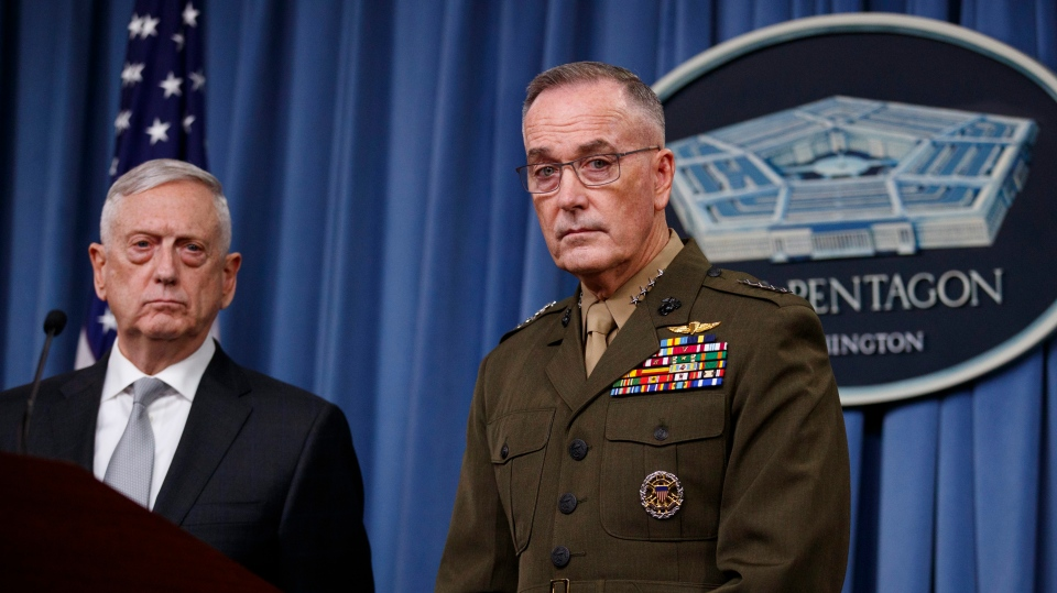 U.S. Defense Secretary Jim Mattis, joined by Joint Chiefs Chairman Gen. Joseph Dunford, speaks at the Pentagon, Friday, April 13, 2018, on the U.S. military response, along with France and Britain, to Syria's chemical weapon attack on April 7. (AP Photo/Carolyn Kaster)