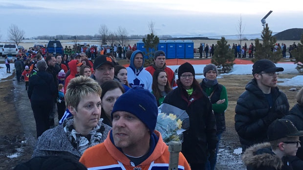 Hundreds of people waiting in line to access the rink at Chinook Winds Park in Airdrie ahead of Friday's vigil