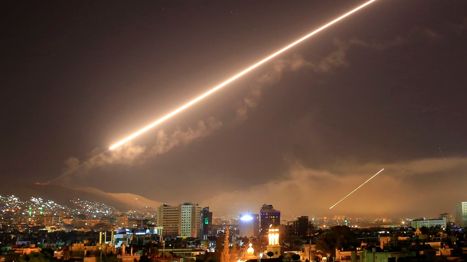 Damascus skies erupt with surface to air missile fire as the U.S. launches an attack on Syria targeting different parts of the Syrian capital Damascus, Syria, early Saturday, April 14, 2018. (AP Photo/Hassan Ammar)