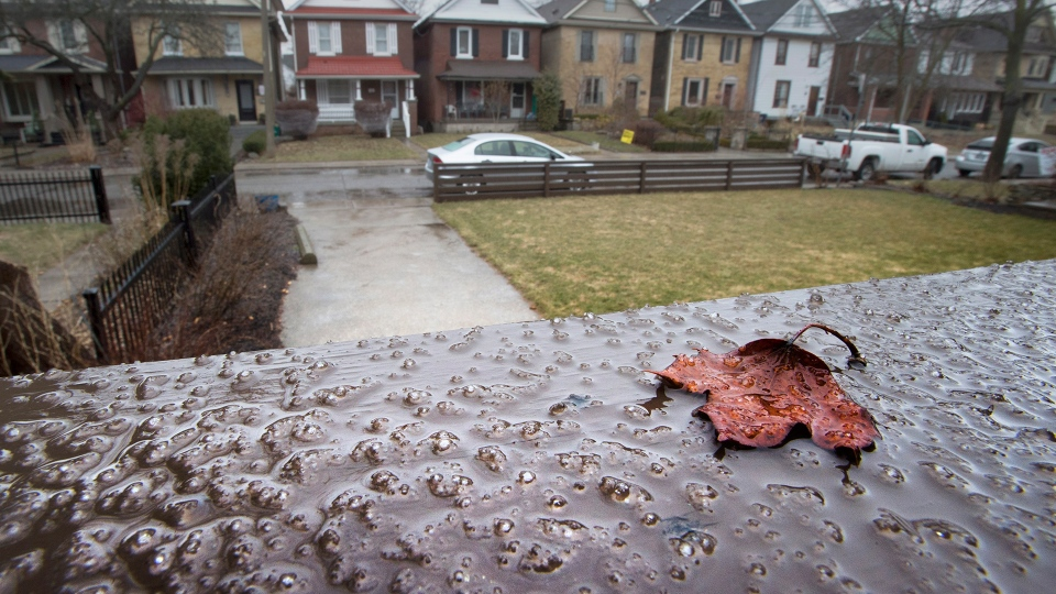 Ice from freezing rain starts to form on a railing in Toronto on Saturday April 14, 2018. (Frank Gunn / THE CANADIAN PRESS)