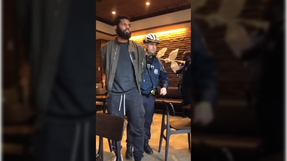 A man is seen being arrested inside a Starbucks in Philadelphia. Police are defending their decision to arrest two black men who tried to use the coffee shop's washroom but hadn't bought anything. (Source: Twitter, Melissa DePino)