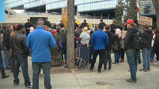 Two groups of individuals squared off in front of Calgary City Hall on Saturday, one in opposition to racism and the other started by Street Church pastor Artur Pawlowski.