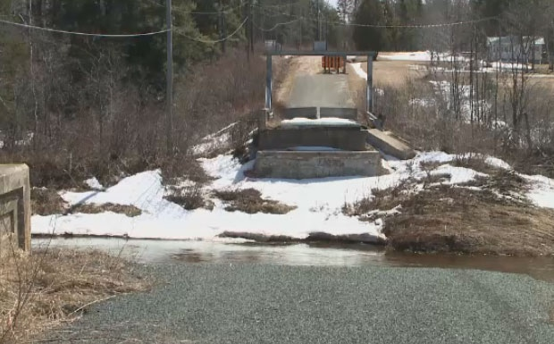 Residents of Cherryvale, N.B. say the government has done nothing to replace the covered bridge that was washed away.