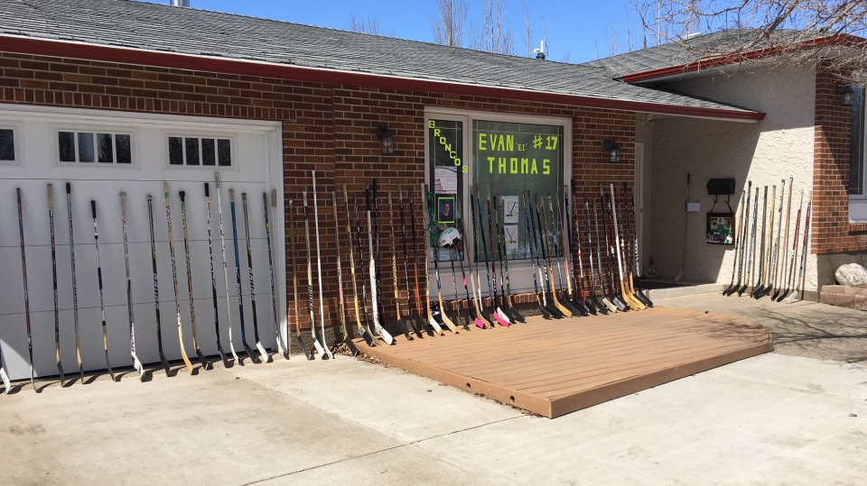 By Saturday, 68 hockey sticks had been placed outside of the home. (Source: CTV News/Beth Macdonell)