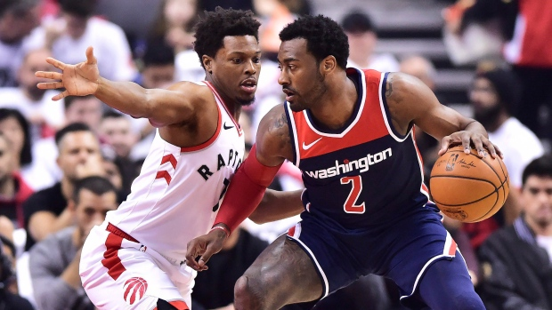 Washington Wizards guard John Wall (2) protects the ball from Toronto  Raptors guard Kyle Lowry (7) during first half round one NBA playoff  basketball action ... 20e948c46