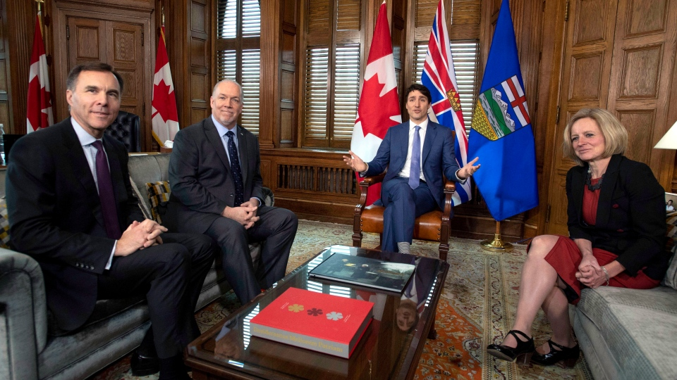 Prime Minister Justin Trudeau speaks before a meeting on the deadlock over Kinder Morgan's Trans Mountain pipeline expansion with B.C. Premier John Horgan, second from left, and Alberta Premier Rachel Notley, as Minister of Finance Bill Morneau looks on, in Trudeau's office on Parliament Hill in Ottawa on Sunday, April 15, 2018. THE CANADIAN PRESS/Justin Tang