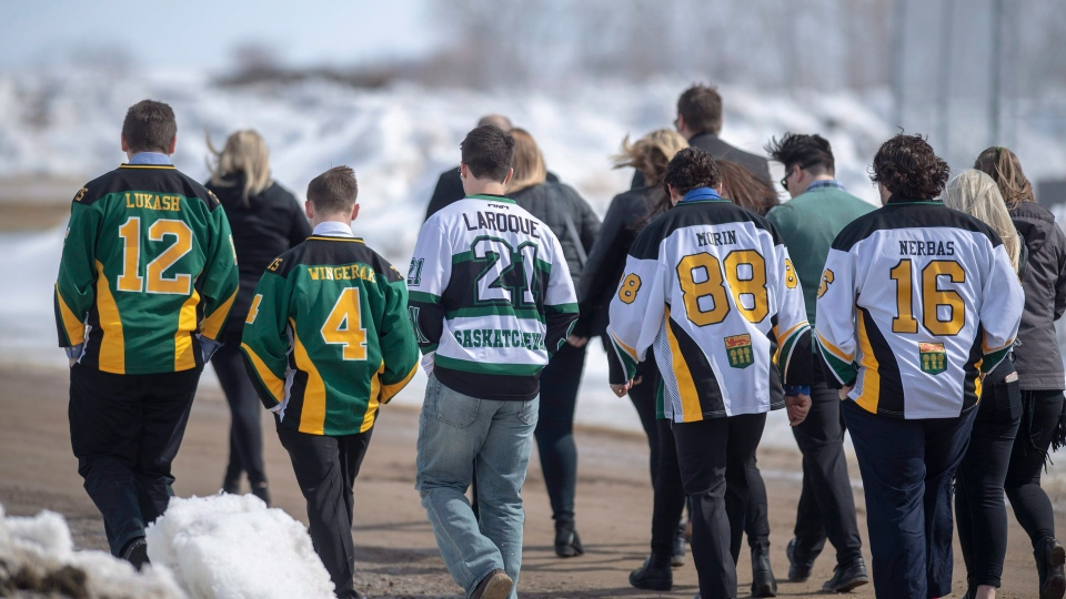 Community members enter memorial service for Logan Schatz, captain of the Humboldt Broncos, one of 16 people killed in a bus crash on April 6th 2018, in Allan, Sask. Sunday, April 15, 2018. THE CANADIAN PRESS/Liam Richards