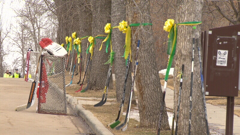 The area surrounding the Glenn Hall Arena, where Tobin's celebration of life was held, was covered in green and yellow ribbons to remember the Broncos goalie.