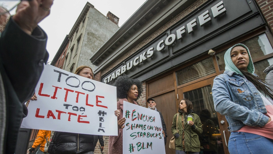 Protesters gather outside of a Starbucks in Philadelphia, on April 15, 2018. (Michael Bryant/The Philadelphia Inquirer via AP)