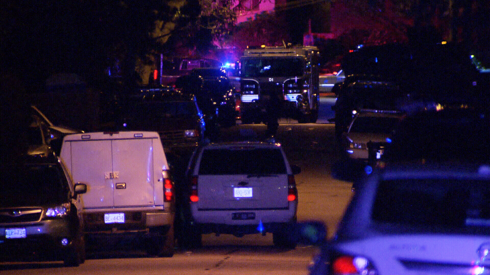 First responders surround a North Vancouver home during a tense, hours-long standoff Monday morning.