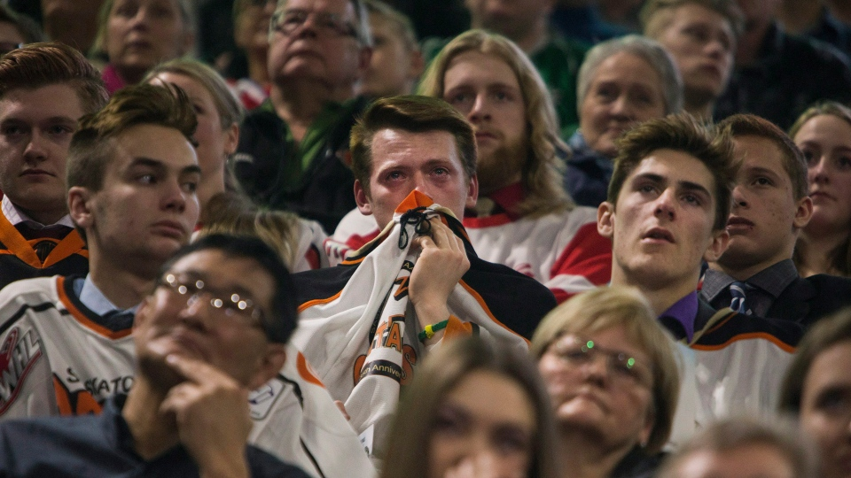 Attendants listen to a tribute during the funeral of Humboldt Broncos player Evan Thomas in Saskatoon on Monday, April, 16, 2018. THE CANADIAN PRESS/Kayle Neis