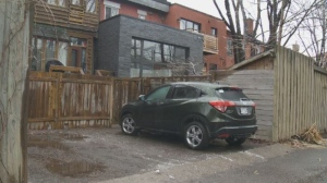 Parking spaces are scarce in the Plateau -- so many homeowners carve out space in their backyards.
