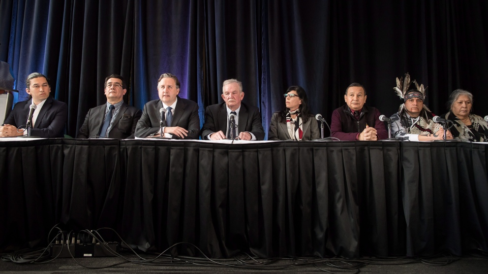 From left to right, Squamish Nation councillor Dustin Rivers (Khelsilem), Chief Bob Chamberlin, Vice-President of the Union of B.C. Indian Chiefs, NDP MP Kennedy Stewart, Burnaby Mayor Derek Corrigan, Vancouver city councillor Andrea Reimer, Grand Chief Stewart Phillip, President of the Union of B.C. Indian Chiefs, and Tsleil-Waututh First Nation members William George and Amy George, attend a news conference to voice their opposition to the expansion of the Kinder Morgan Trans Mountain pipeline, in Vancouver, B.C., on Monday April 16, 2018. (THE CANADIAN PRESS/Darryl Dyck)