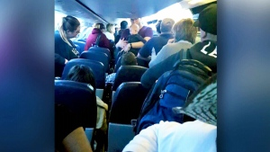 Waiting on a plane for hours, passengers claimed they were not given any food, water or blankets. (CTV)