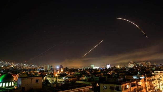 Missiles streak across the sky in Syria