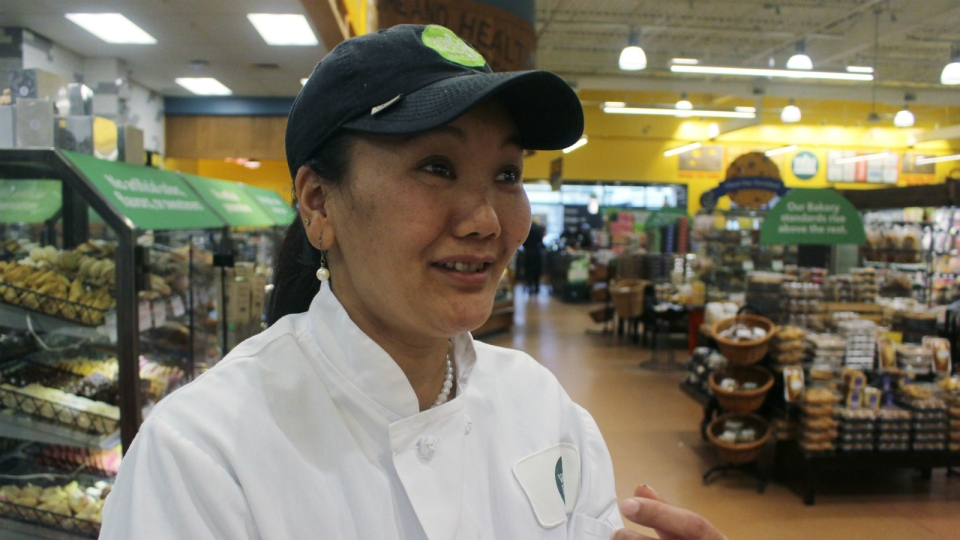 Mountain climber Lhakpa Sherpa prepares to start her shift as a dishwasher at the Whole Foods Market in West Hartford, Conn. on April 3, 2018. (AP Photo/Pat Eaton-Robb)