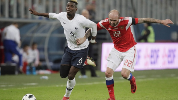 Konstantin Rausch, right, duels with Paul Pogba