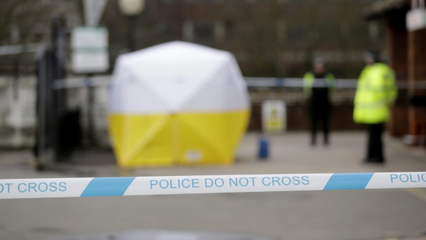 Officers guard a cordon around a police tent