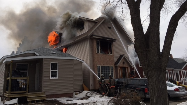 Flames shoot from a home on Saskatoon's Avenue C North on Monday, April 16, 2018. (Saskatoon Fire Department)