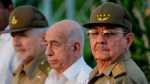 In this July 26, 2009 file photo, Cuba's authorities, from right, President Raul Castro, Vice-President Jose Ramon Machado Ventura and Revolutionary Commander Ramiro Valdes attend a rally marking Cuba's Day of National Rebellion in Holguin, Cuba. (AP Photo/Javier Galeano, Pool, File)