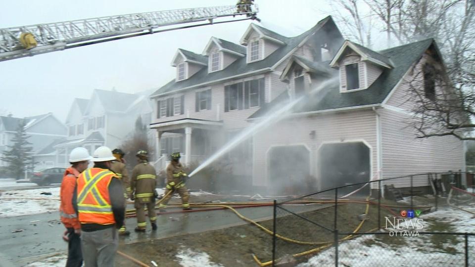 Firefighters battle a blaze at an Ottawa-area home.