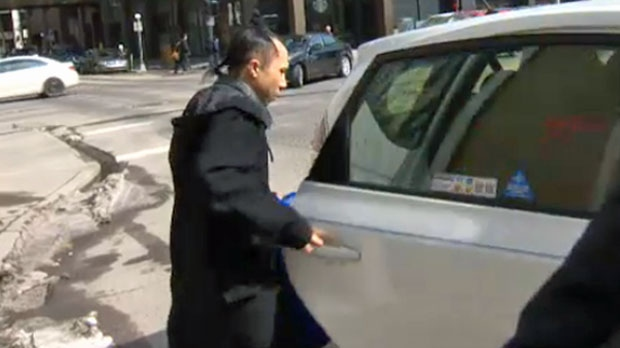 Nick Chan enters a taxi outside the Calgary Courts Centre on April 17, 2018 after having his murder charge stayed.