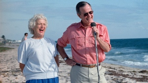In this Nov. 14, 1998 photo, President-elect George H.W. Bush and his wife, Barbara, are shown during a morning beachfront news conference in Gulf Stream, Fla. (AP Photo/Kathy Willens)