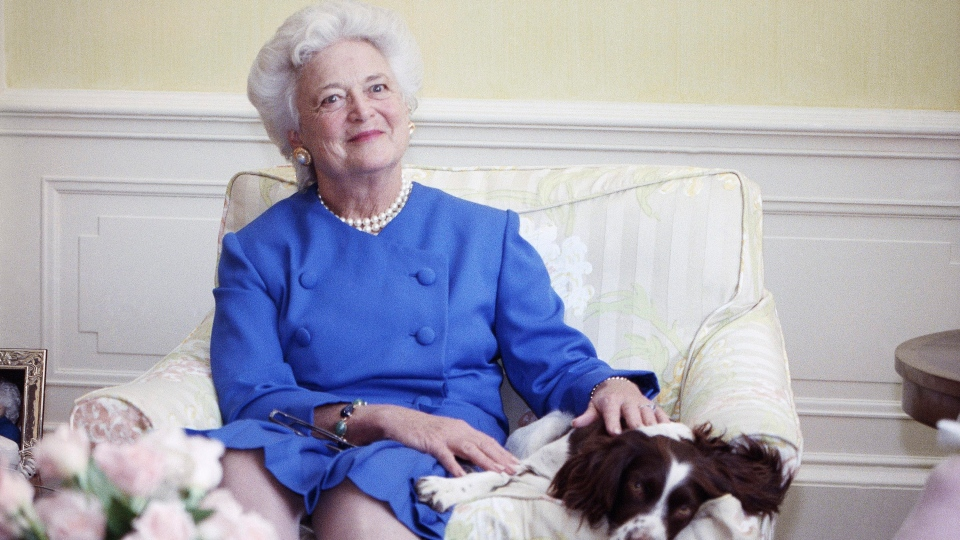 In this 1990 file photo, first lady Barbara Bush poses with her dog Millie in Washington. A family spokesman said Tuesday, April 17, 2018, that former first lady Barbara Bush has died at the age of 92. (AP Photo/Doug Mills, File)